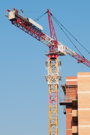 Lift crane building a new residential building Stock Photo