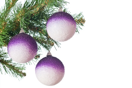 Three gold balls on a Christmas fur-tree photo