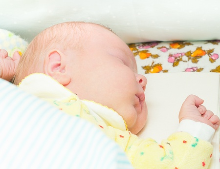 little newborn baby sleeps with his mouth open Stock Photo - 11222577