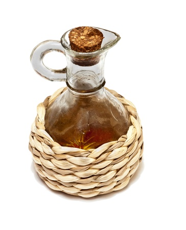 Wicker bottle of olive oil photo