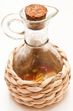 Wicker bottle of olive oil photo