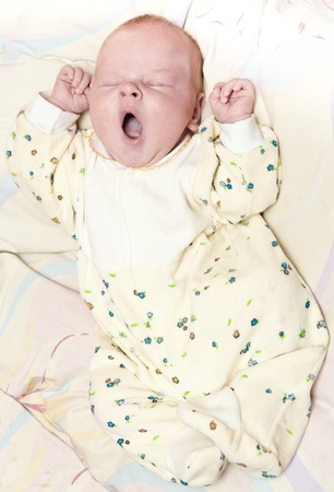 Newborn baby lying in a blanket