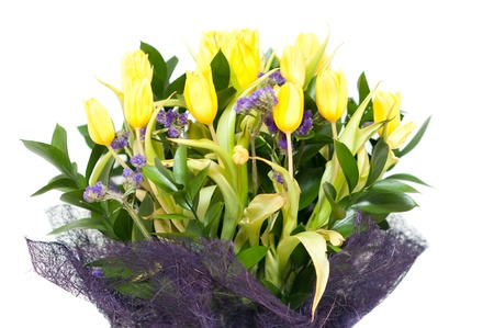 a large bouquet of yellow tulips in spring photo