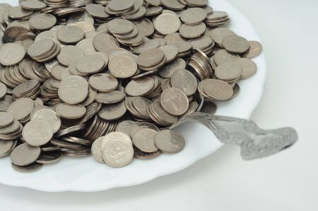 small coins on a plate with cutlery Stock Photo - 12044242