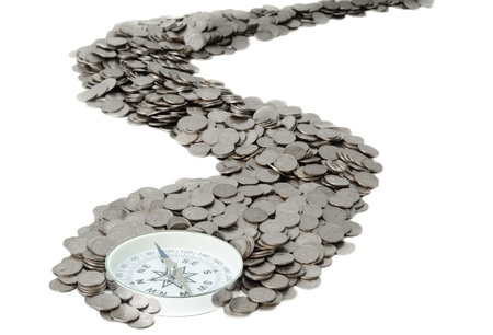 Compass is at the beginning of the road from coins Stock Photo - 12044253