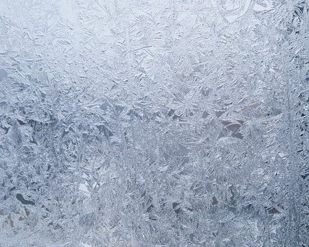 background of pure white snow and the snowflakes