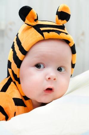 Newborn baby lying in a blanket photo