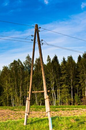capacitance: Electric wires on a column about high volt Stock Photo