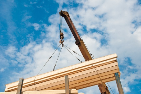 crane loading timber on pallet photo