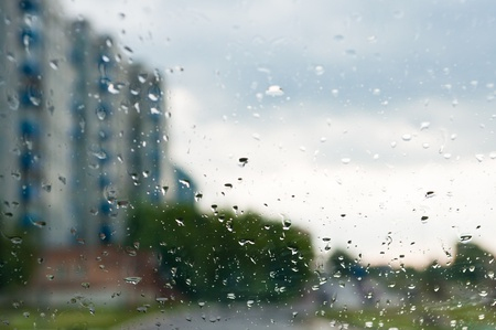 rain drops on glass with a background photo