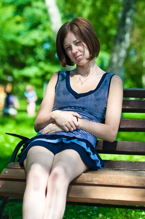 quietly: young girl on a park bench