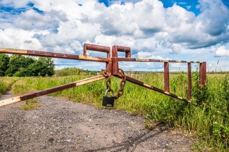 barrier in a field on the lock with a chain photo