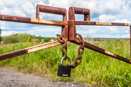barrier in a field on the lock with a chain Stock Photo - 14288665