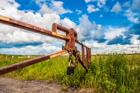 barrier in a field on the lock with a chain Stock Photo - 14288734