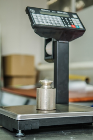 standard steel: electronic scales in the store with weights Stock Photo