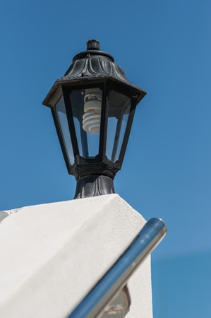 street lamp on the wall against the blue sky Stock Photo - 15476694