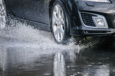 road surface: Car rides on big water in the rain