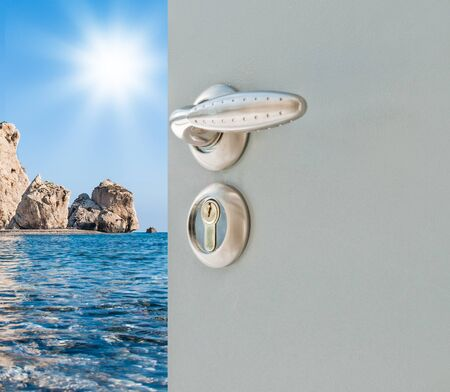 exposed metallic gray door with a sea view