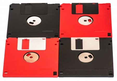 old obsolete colored floppy disks on a white background photo