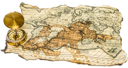 old burnt World Map with compass on a white background Editorial