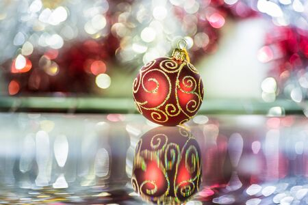 red Christmas ball ornaments on a background tinsel photo