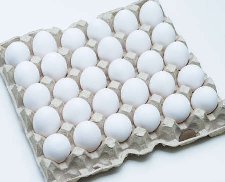 reliably: chicken egg white neatly stacked in a cell Stock Photo