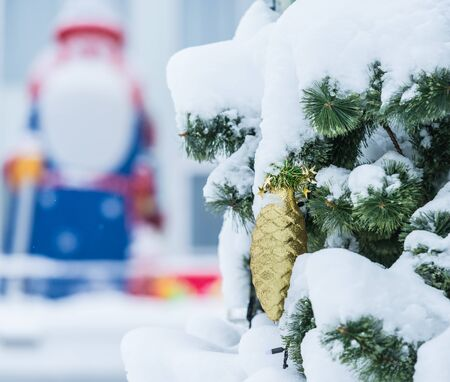 no snow: gold pine cone ornament Christmas tree with no snow