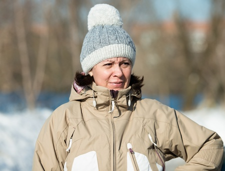 middle-aged woman in a ski jacket and a hat with pompom Stock Photo - 18030888