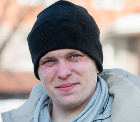 portrait of a man in a cap and scarf in winter photo