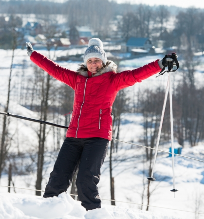 downhill skiing: middle-aged woman alpine skiing in the snow in winter Stock Photo