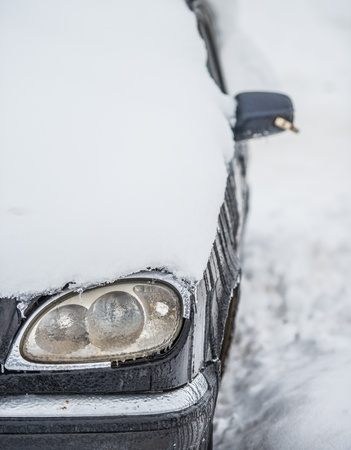 silver car filled up with snow in winter Stock Photo - 18302225