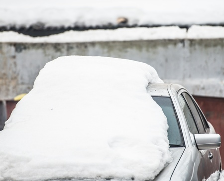 silver car filled up with snow in winter Stock Photo - 18302222