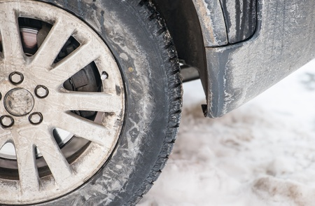 dirty car wheel stands on winter snowy road Stock Photo - 18302238