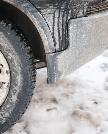 dirty car wheel stands on winter snowy road Stock Photo - 18302232