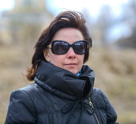 portrait of a middle-aged brunette in a black jacket fall photo