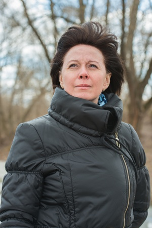 age 40 45 years: portrait of a middle-aged brunette in a black jacket fall Stock Photo