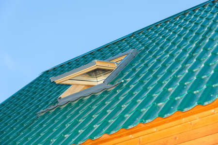 green tile roof house with a built-in window