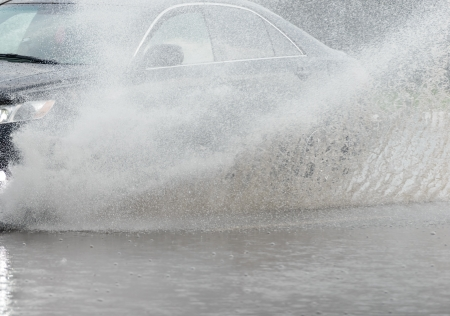 Car rides on big water in the rain photo