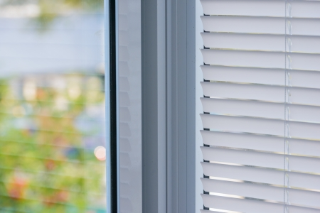 closed plastic blinds on the window with the reflection in the glass Stock Photo - 21402942