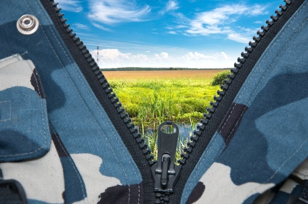 natural landscape seen through the unbuttoned zippers photo