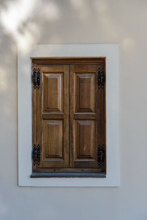 window in the plastered wall of old wooden shutters closed Stock Photo - 22824009