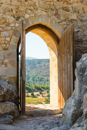 old wooden arch in the fortress with open doors photo