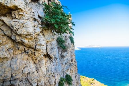 landscape Aegean seaside bay with a rocky shore photo