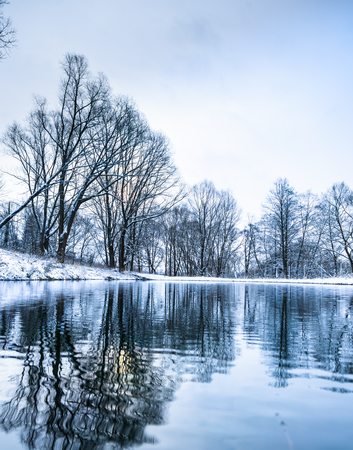 landscape is not still pond with snowy shore Stock Photo - 24433542