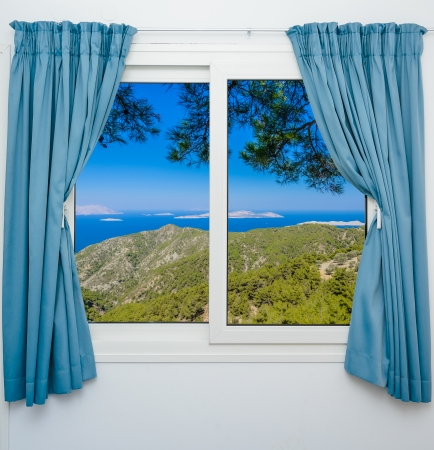 nature landscape with a view through a window with curtains photo