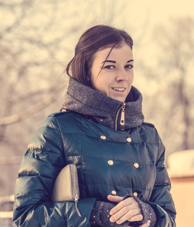 Young brunette woman in a winter jacket portrait photo