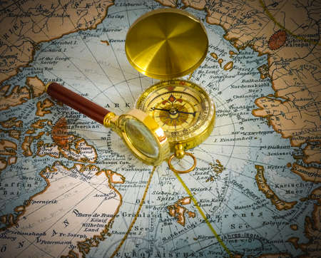 compass and magnifying glass lie on the topographic map photo