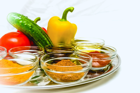 variety of spices and seasoning for cooking in glass cups photo