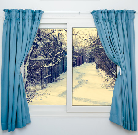 view from the window of a winter forest photo