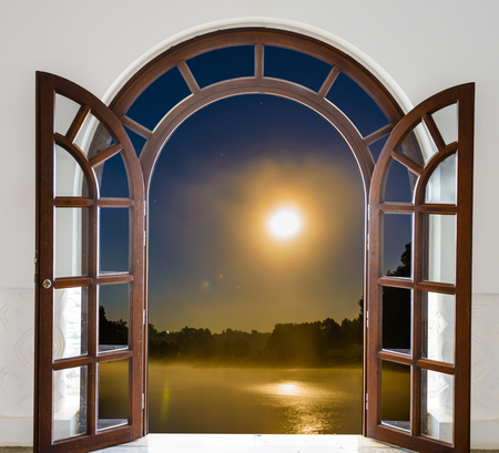 moon gate: open door view night landscape with the big moon Stock Photo
